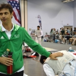 Coach Sergei at tournament with GFC fencer.